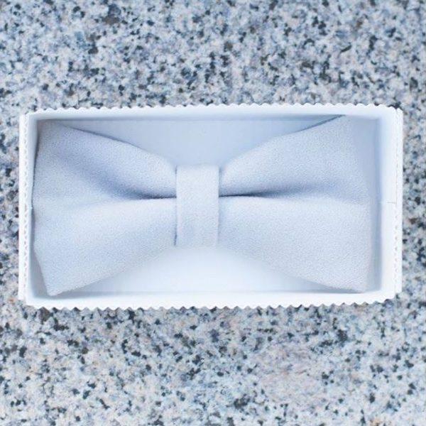 a white soft unique handmade designer bow tie in a white box