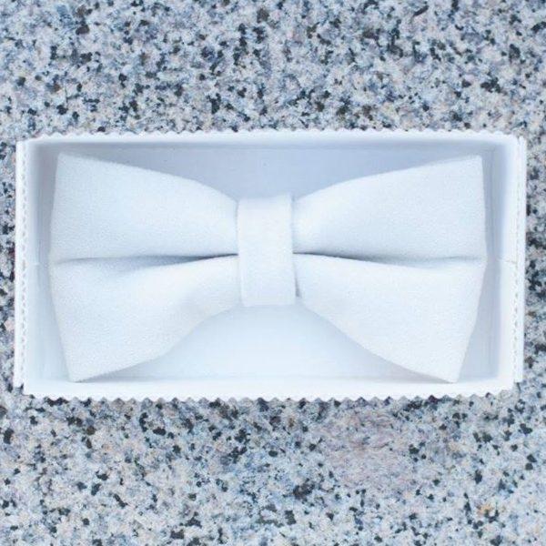 a clear white handmade unique designer bow tie in a white box