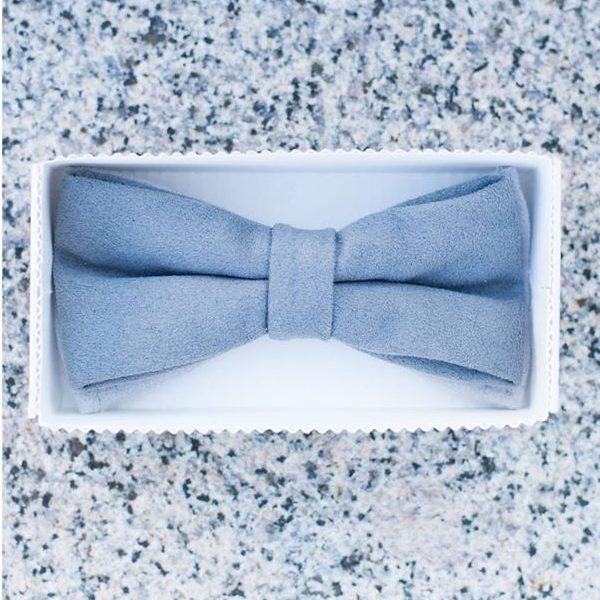 a soft unique handmade designer dark blue bow tie in a white box